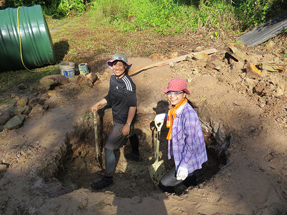 Japanese students dig hole for septic tank