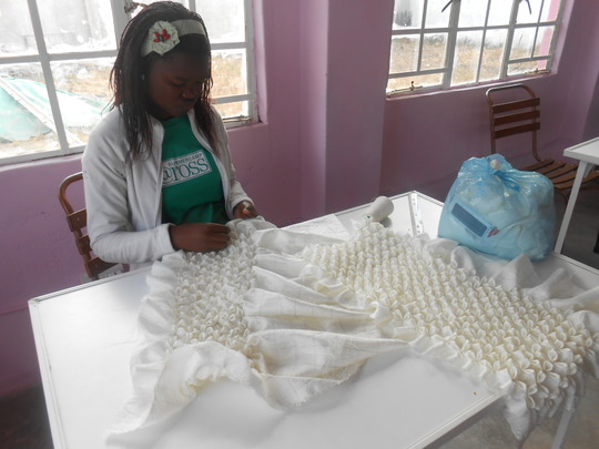 Charity working on a pillow cover for a client