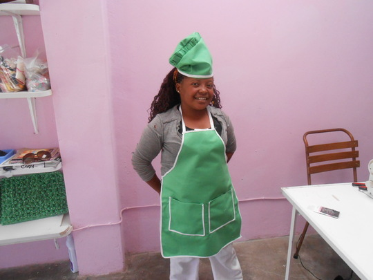 Lindiwe with her apron and hat made for a client