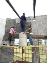 Sithabisiwe plastering cement on new building