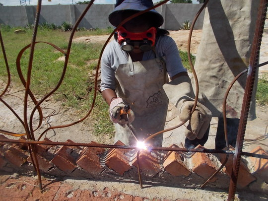 Multi-talented Lindiwe welding our railing