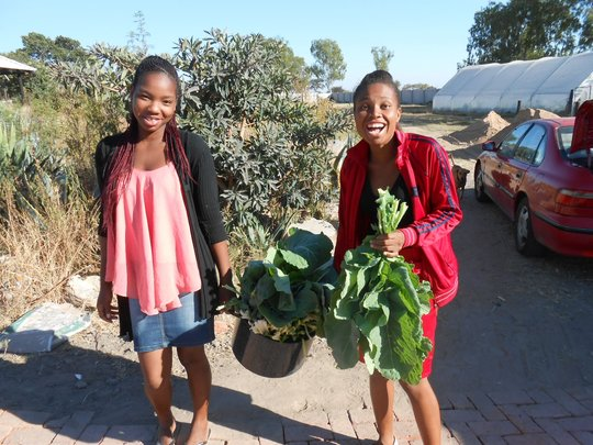 Samantha and Pauline with a day's harvest