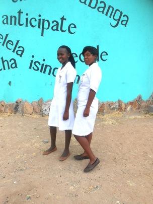 Thamani and Hloniphile in their nurse aide uniform