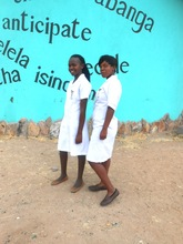 Thamani and Hloniphile in their nurse aide uniform