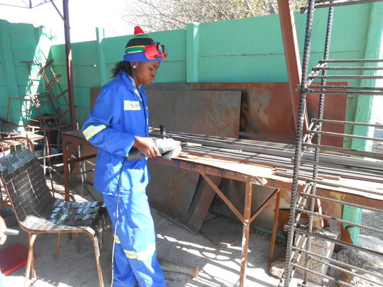 Thamani is preparing parts for a client order.
