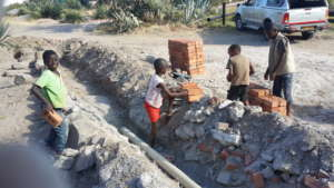 The little ones loved learning to lay brick path