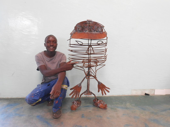 Nkosi with his sculpture