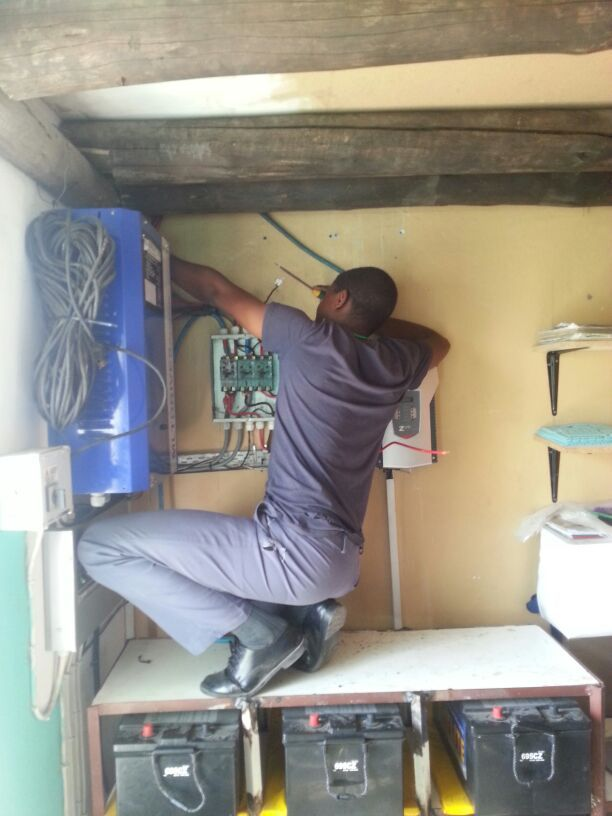 Ngqabutho maintaining our solar electric equipment