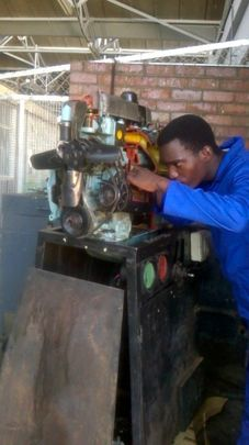 Shaun learning auto mechanics at training course