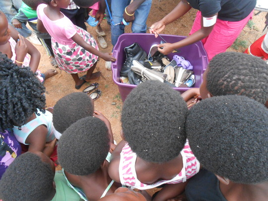 Distributing shoes to our outreach kids