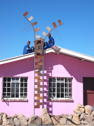 Ngqabutho (left) with zipper on sewing building