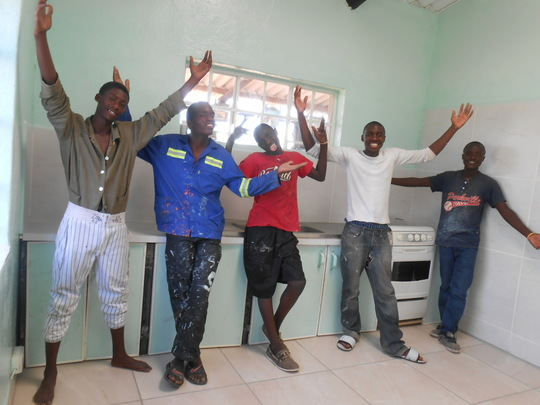The proud Zimkids tile team in new kitchen