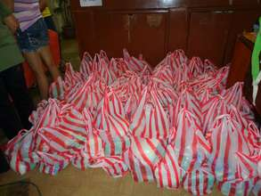 Each Bag Contains Food, Medicine, and Soap