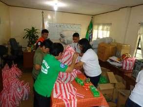 AAI Staff Preparing Aid Materials