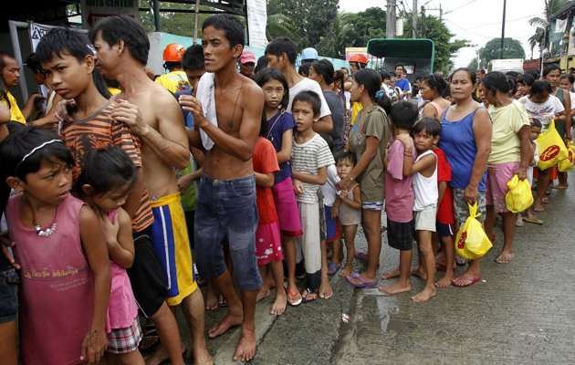 Waiting in Line for Emergency Assistance (Reuters)