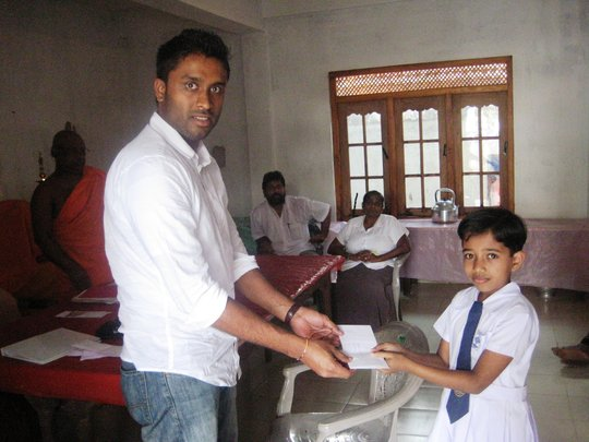Educate Lanka Student reciving her Scholarship