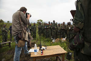 RISC trainee Pete Muller photographing in Congo