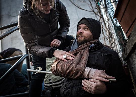 Andrea Bruce puts a splint on Michel Huneault