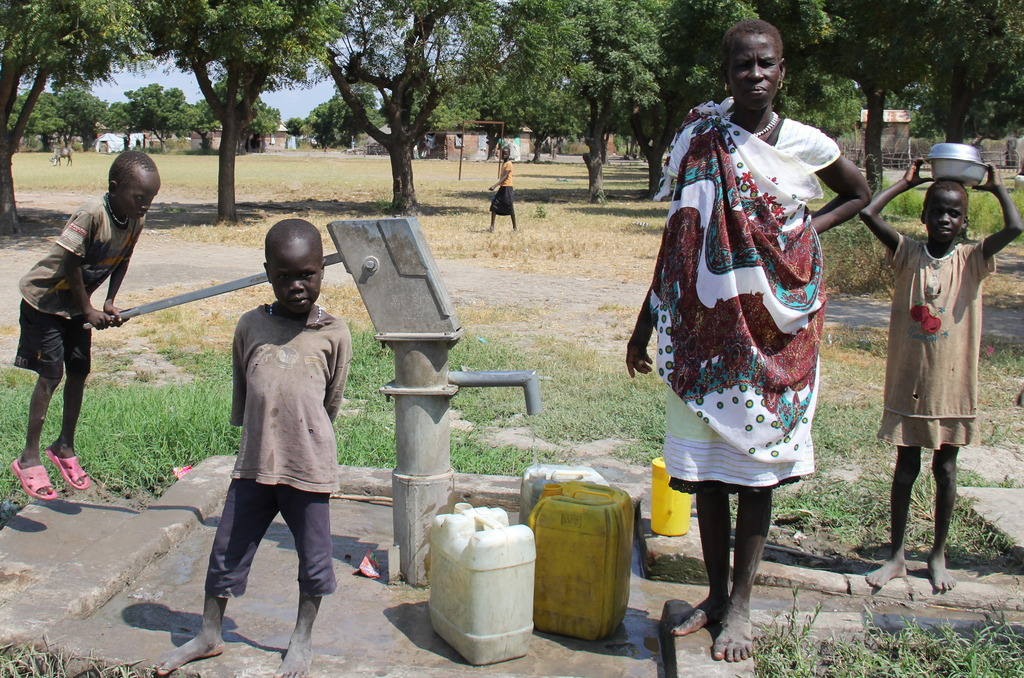 A family gathering water from an ASMP well