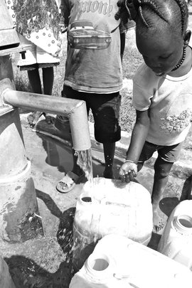 Kids receiving water for the first time
