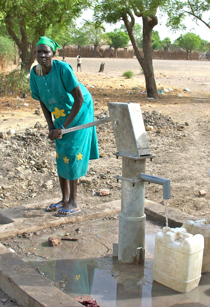 Woman pumping at a new well