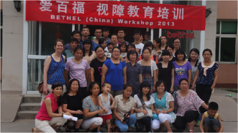 Group of workshop participants and Bethel teachers