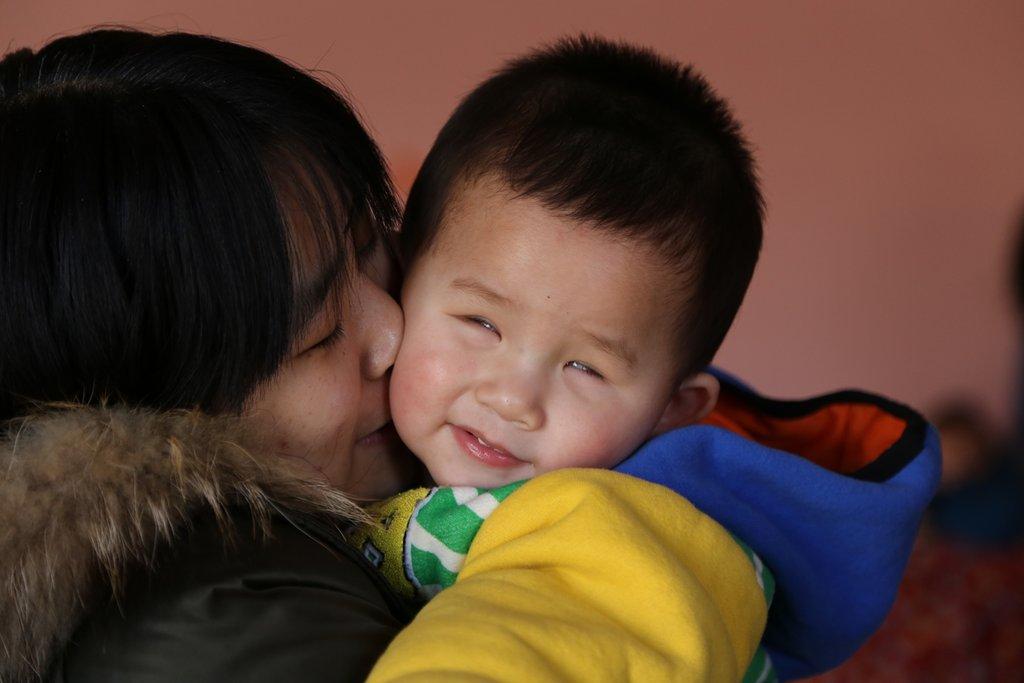 Qiu Ye (Luke) gets a cuddle from his Bethel mama