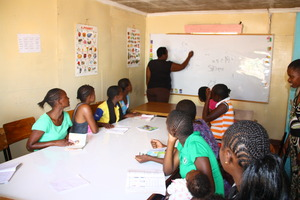 Girls attending class at the shelter