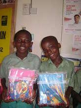 School children holding their school materials