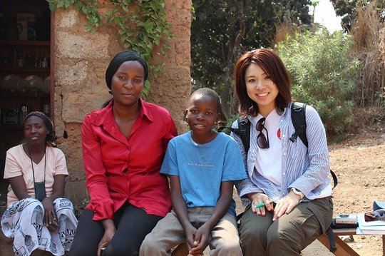 One of our beneficiaries and a staff of AAR Japan