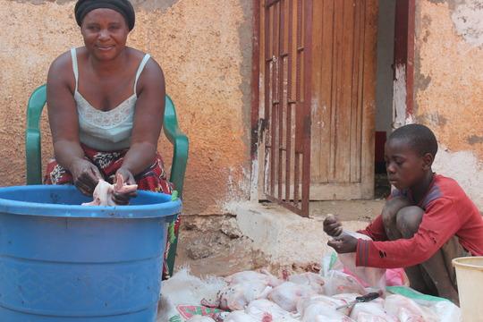 Preparing chickens for sale. September 2011
