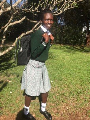 Lilian in school uniform.