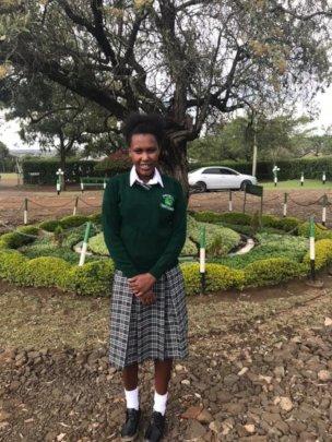 Pulei in her new school uniform