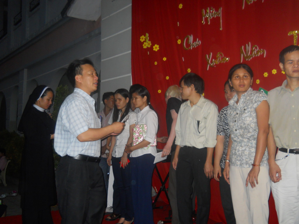 Rev Thuan Hoang with former students of Nhat Hong