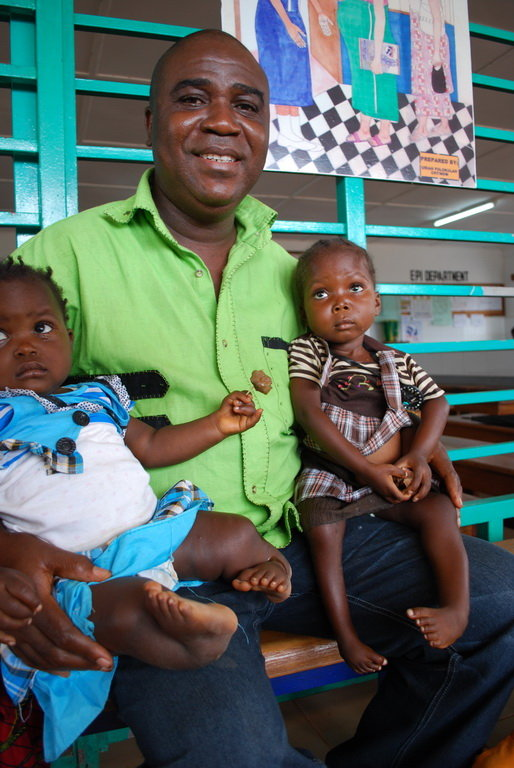 Director of FACORC with two babies with clubfoot.