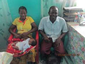 Family in Liberia with their week old child.