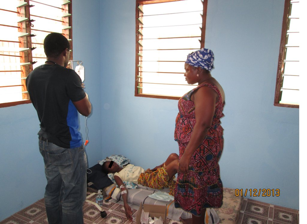 The doctor and Sister Kafui, administering to C.A.