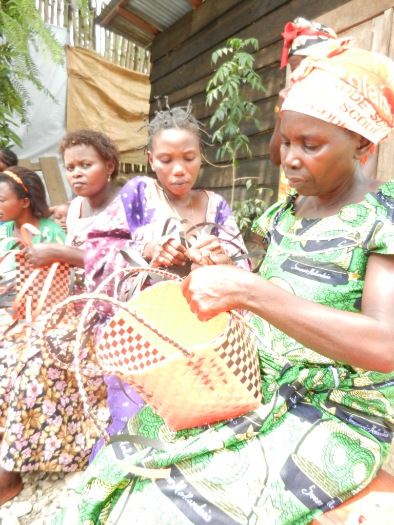 weaving baskets at the Community Resource Center