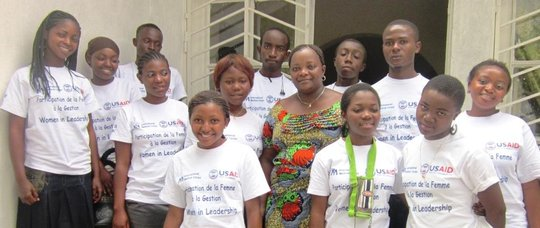 Adolescents Club members posing with Madam Pauline