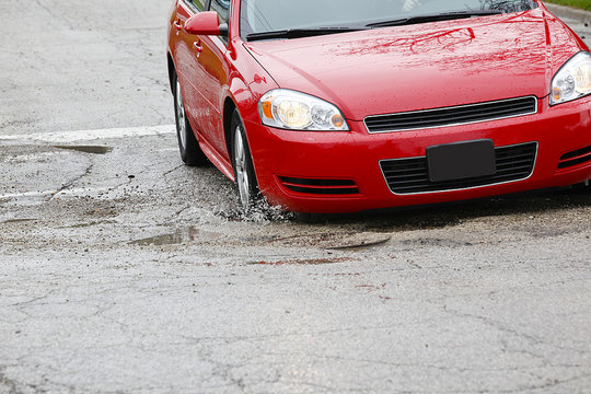Pothole-ridden roads (CC courtesy State Farm)