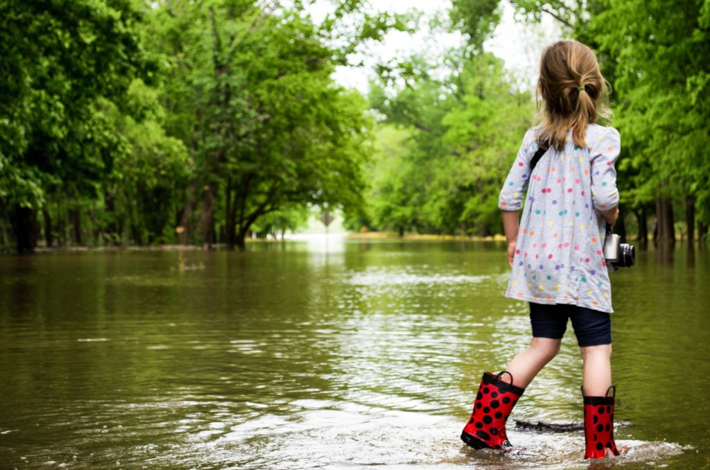 Girl Walking Through Flood
