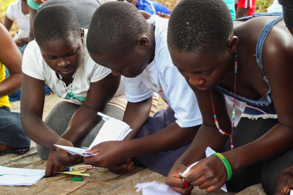 Children making own pads