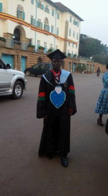 Joseph on his graduation gown