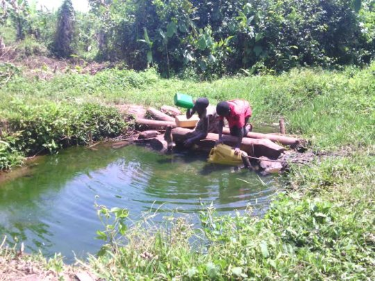 Children fetch water from un protected well