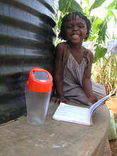 Smilling girl with solar lamp