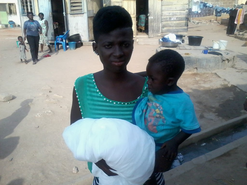 Margaret and child. Note the open drainage behind