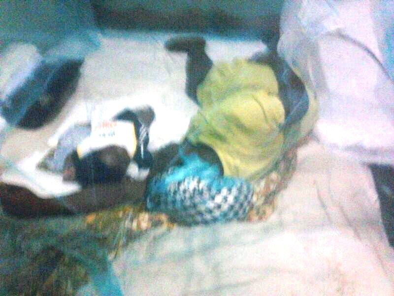 A benificiary sleeping with her baby