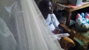 Beneficiary and her week old baby