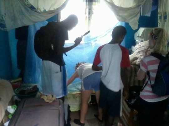 Installing bed net for a young mother