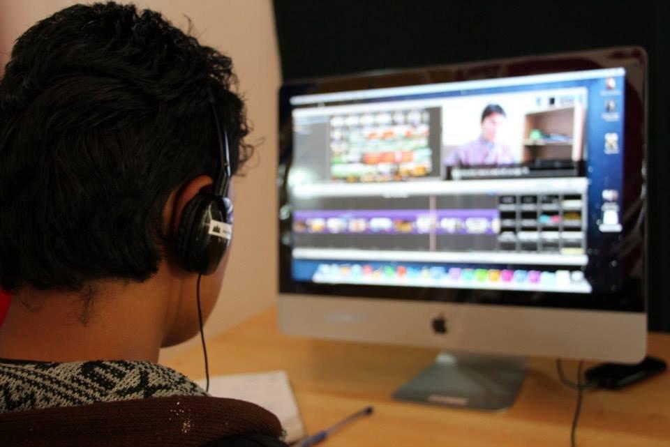 Kelzang edits his micro-documentary on a Lab Mac